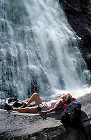 CANADA, ALBERTA, KANANASKIS, MAY 2002. A hiker takes a sunbath at the Ribbon Falls.  The Kananaskis Country provincial park is home to Canada's most beautiful nature and wildlife. It has also escaped the mass tourism as in Banff National Park. Photo by Frits Meyst/Adventure4ever.com