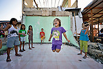 Princess Angel Moristo, 7, jumps rope amid the rubble in Tacloban, a city in the Philippines province of Leyte that was hit hard by Typhoon Haiyan in November 2013. The storm was known locally as Yolanda. The ACT Alliance has been active here and in affected communities throughout the region helping survivors to rebuild their homes and recover their livelihoods.