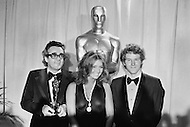 10 Apr 1972, Los Angeles, California, USA. French music composer Michel Legrand holding his Oscar for Best Original Score, for the music of the film Summer of '42 directed by Robert Mulligan at the 44th Academy Awards.  Also present are American actors Cloris Leachman (C) and Timothy Bottoms who starred in The Last Picture Show. Leachman was awarded the Best Supporting Actress Oscar for her role.