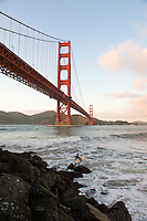 Surfers Under Golden Gate Bridge at Fort Point - San Francisco - California
