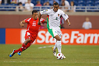 Panama midfielder Amilcar Henríquez (21) and Guadeloupe midfileder David Fleurival (6) during the CONCACAF soccer match between Panama and Guadeloupe at Ford Field Detroit, Michigan.