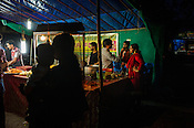 Families gather at a food stall in Kochi, Kerala, India.
