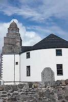 The unusual circular shape of the church at Bowmore is said to discourage the devil from hiding himself in corners