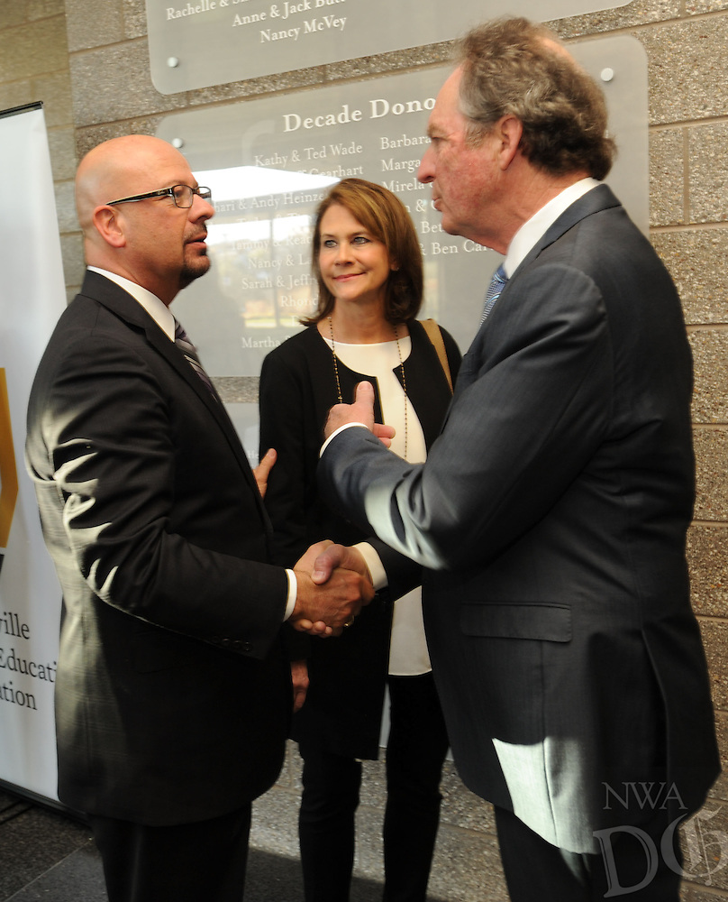 NWA Democrat-Gazette/ANDY SHUPE<br /> Matthew Wendt (left), incoming superintendent of Fayetteville Public Schools, speaks Wednesday, March 16, 2016, with Neal and Gina Pendergraft during an announcement of a $250,000 grant to the Fayetteville Public Education Foundation from the Donald W. Reynolds Foundation to support the Neal R. Pendergraft Endowment at Fayetteville High School.