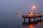 Fishing pier with tanker in Elliott Bay at sunrise in fog