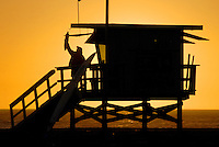 Sherry, a Los Angeles County Lifeguard, closes her tower at Santa Monica Beach on Tuesday, October 26, 2010.