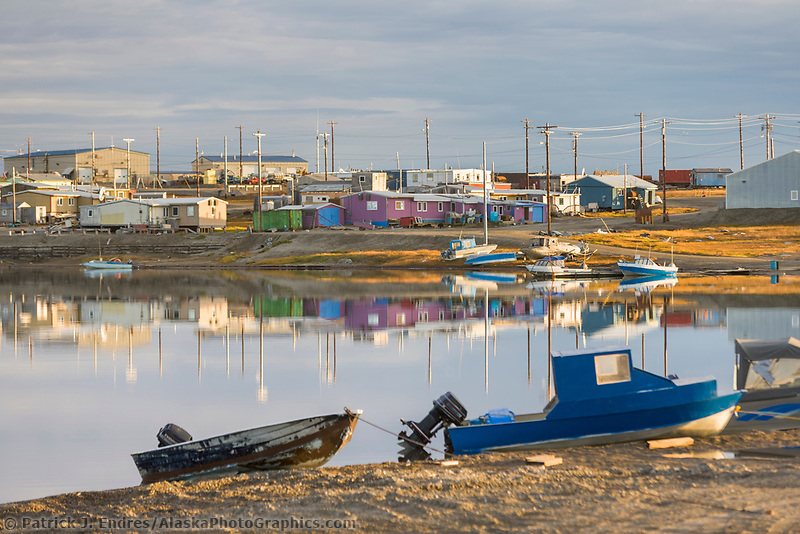 Inupiat native village of Kaktovik, on Barter Island, in the Beaufort Sea along Alaska's arctic coast. Sea ice dots the waters in the distance.