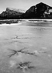 Cracks in the ice appear as frozen tendrils of lightning on the second Vermilliion Lake in Banff National Park, Alberta Canada.