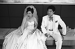 The Peoples Republic of China. Shanghai. The Venus Plaza Wedding Studio.  The fashion for Western white weddings became popular among affluent middle class Chinese in the 1930s, and reappeared in the late 1980s. You will find the bride is still wearing traditional red shoes for good luck. FROM THE BOOK SHANGHAI ODYSSEY BY HOMER SYKES WITH THE SUPPORT OF THE GRIMSTONE FOUNDATION. PUBLISHED BY DEWI LEWIS PUBLISHING ISBN 1-89923514-0