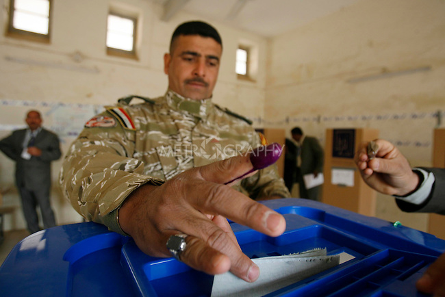 KARBALA, IRAQ; Policemen vote in Sulaimaniyah..Three days before the polls open, military and convicts vote in the Iraqi Parliamentary Elections....Photo by Metrography