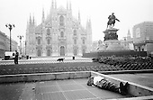 From Homeless series.Homeless sleeping in Duomo square Milan Italy