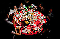 Diners, at The West Lake Restaurant, sit around a circular table laiden with an array of dishes. The West Lake Restaurant is the biggest Chinese restaurant in the world, able to seat up to 5,000 people at one sitting. Each week its diners, who staff are taught are 'the bringers of good fortune', devour 700 chickens, 200 snakes, 1,200 kgs of pork and 1,000 kgs of chillis. Its 300 chefs cook in five kitchens and its staff total more than 1,000.It is fully booked most nights.