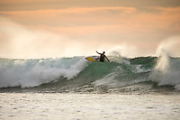 Bells Beach, Torquay, Victoria, Australia (Wednesday, March 23 2016): Courtney Conlogue (USA) - <br /> Bells Beach has been hosting surfing tournaments for more than 50 years now, making it the most renowned spot on the raw and rugged southern coast of Victoria, Australia. The list of  Rip Curl Pro event champions is a veritable who's who of surfing icons, including many world champions.<br /> <br /> Surfing's greats have a way of dominating Bells. Mark Richards, Kelly Slater, and Mick Fanning all have four Bells trophies; Michael Peterson and Sunny Garcia, three; While Simon Anderson, Tom Curren, Joel Parkinson, Andy Irons, and Damien Hardman each grabbed a pair.<br /> <br /> The story is similar on the women's side. Lisa Andersen and Stephanie Gilmore have four Bells titles; Layne Beachley and Pauline Menczer, three; while Kim Mearig and Sally Fitzgibbons each have two.<br /> <br /> The 2016 event is about to kick off tomorrow and there was a packed warm up session at Bells this morning. <br /> Photo: joliphotos.com