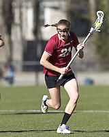Harvard University midfielder Audrey Todd (21) brings the ball forward.