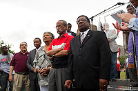 North Carolina legislators who voted against the contentious Republican legislation stand near the podium during the ninth Moral Monday protest at the North Carolina State Legislature in Raleigh, July 1, 2013.