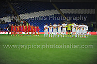 Cardiff City Stadium, Friday 11th Oct 2013. Both teams line for 1 minutes silence during the Wales v Macedonia FIFA World Cup 2014 Qualifier match at Cardiff City Stadium, Cardiff, Friday 11th Oct 2014. All images are the copyright of Jeff Thomas Photography-07837 386244-www.jaypics.photoshelter.com