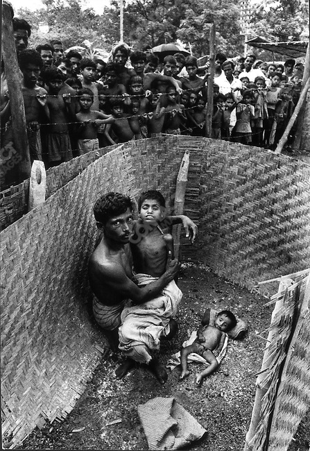 Cholera outbreak after monsoons, war refugee camp, border of India and Bangladesh, 1971