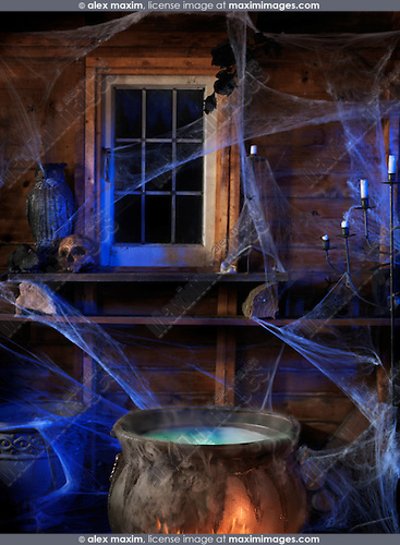 Steaming potion in a cauldron inside a witch cabin