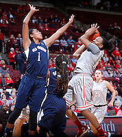 Ohio State Buckeyes guard Ameryst Alston (14) shoots while guarded by Old Dominion Lady Monarchs forward Shae Kelley (1) during Friday's NCAA Division I basketball game at Value City Arena in Columbus on November 22, 2013. Ohio State won the game 75-60. (Barbara J. Perenic/The Columbus Dispatch)