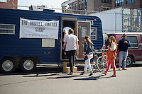 Customers enter The Mobile Vintage Shop in the Bushwick neighborhood of Brooklyn in New York on Saturday, April 27, 2013. The neighborhood is undergoing gentrification changing from a rough and tumble mix of Hispanic and industrial to a haven for hipsters, forcing many of the long-time residents out because of rising rents.  (©Frances M. Roberts)