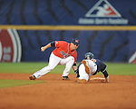 Ole Miss' Kevin Mort tags out Auburn's Justin Fradejas, who was caught off first base, during the Southeastern Conference tournament at Regions Park in Hoover, Ala. on Friday, May 28, 2010.  (AP Photo/Oxford Eagle, Bruce Newman)