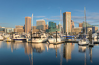 Part of the skyline of Baltimore, Maryland, including the Transamerica Tower and the  World Trade Center, is reflected in the waters of the Inner Harbor during the first hour after sunrise.