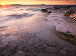 Georgian Bay, beautiful sunset nature scenery in golden colors. Bruce Peninsula National Park, Ontario, Canada.
