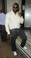 Audley Harrison.The Prince Albert II of Monaco Olympians Reception, Old Burberry Building, Haymarket, London, England..August 9th, 2012.full length sunglasses shades white shirt jeans denim stripe beard facial hair hand fist.CAP/CAN.©Can Nguyen/Capital Pictures.