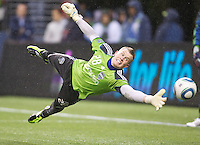 Sounders FC goalkeeper  Terry Boss dives to make a save before play between the Seattle Sounders FC and the L.A. Galaxy at Qwest Field in Seattle Tuesday March 15, 2011. The Galaxy won the game 1-0.
