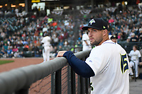 Left fielder Tim Tebow (15) of the Columbia Fireflies in the dugout between innings of his first Class A game against the Augusta GreenJackets on Opening Day, Thursday, April 6, 2017, at Spirit Communications Park in Columbia, South Carolina. (Tom Priddy/Four Seam Images)