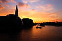 London, UK. 07.04.2015. View from Tower Bridge, at sunset, towards the Shard. Photograph © Jane Hobson.