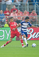 July 24, 2010  FC Dallas midfielder Bruno Guarda #8 and Toronto FC defender Adrian Cann #12 in action during a game between FC Dallas and Toronto FC at BMO Field in Toronto..Final score was 1-1.