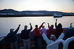 Aboard the National Geographic Sea Lion as we depart Portland, Oregon for Astoria, Oregon. Passengers wave to the sister ship, the Sea Bird, as we pass each other along the Willamette River.