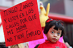"""The daughter of one of the electric workers women holds a banner that reads """"I'm two years old and I'm on the streets because my mom is an unemployed"""", during a protest outside the Federal Electricity Commission (CFE) where eleven women started a hunger strike demanding the federal government to reverse the decision of dissolving the Luz y Fuerza del Centro state company, November 23, 2009. Photo by Heriberto Rodriguez"""