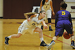 Ketchikan's Madison Rose goes for a  steal from Lathrop's Makenzie Warner in their Dimond Lady Lynx Prep Shootout basketball game Friday, February 10, 2017.  Photo for the Daily News by Michael Dinneen