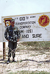 A U.S. soldier stands next to a sign for the 610th Transportation Company during the Vietnam War. This images is from the collection of J.W. Womble of the 610th Transportation Company during the Vietnam War.