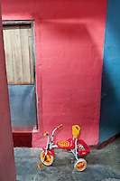 Childs tricycle on a small street off Jampettah Street.