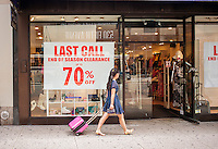 A store on fifth Avenue in Midtown Manhattan in New York announces a seasonal clearance sale, seen on Sunday, July 21, 2013. Because of an unseasonable cold and wet spring, resulting in unsold inventory,  many merchants intend on keeping inventories of back-to-school merchandise low.   (© Richard B. Levine)