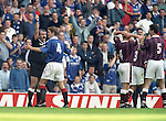 Rangers captain Richard Gough pleads for common sense from referee Gerry Evans as he sends off Paul Ritchie, the fourth Hearts player to see a red card on the afternoon of 14th September 1996. Hearts finished with seven players