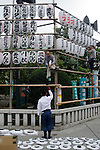 workers install paper lanterns at Tokyo's Asakusa located Senso-ji temple complex