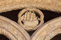 Sculptural detail of a ship, celebrating Portugal's Age of Discovery, between the arches of the arcade of the Cloister, built in Manueline style by Diogo Boitac, Joao de Castilho and Diogo de Torralva, completed 1541, in the Jeronimos Monastery or Hieronymites Monastery, a monastery of the Order of St Jerome, built in the 16th century in Late Gothic Manueline style, Belem, Lisbon, Portugal. The cloister wings have wide arcades with rectangular column and tracery within the arches. The monastery is listed as a UNESCO World Heritage Site. Picture by Manuel Cohen
