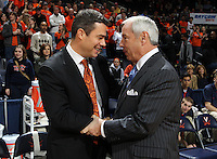 Jan. 8, 2011; Charlottesville, VA, USA; Virginia Cavaliers head coach Tony Bennett, left, shakes hands with North Carolina Tar Heels head coach Roy Williams, right, during the game at the John Paul Jones Arena. Mandatory Credit: Andrew Shurtleff