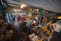 """NWA Democrat-Gazette/J.T. WAMPLER Christinia """"Fats"""" James checks out customers Thursday Feb. 2, 2017 at the Oark General Store. The store was established in 1890 and is a destination for motorcyclist and tourists from all over the world."""