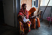 25 year old Dayawati (right) and her 17 month son, Naresh Mukhiya wait to meet the health worker and seek other medical benefits at the local health centre in Hanuman Nagar in Saptari, Nepal. <br /> Naresh Mukhiya was first admitted on July 17, 2013 when he was 9 months old. MUAC - 109 mm, Weight - 5.5kg, and Height - 65 cm. He was discharged on Oct 1st, 2013. MUAC at the time of discharge - 123, Weight - 6.5 Kg, Height - 66cm. Total RUTF consumes - 148 sachets.Gain of weight - 2gm.day.