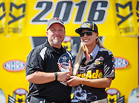 Sep 18, 2016; Concord, NC, USA; NHRA top fuel driver Leah Pritchett (right) with journalist Bobby Bennett during the Carolina Nationals at zMax Dragway. Mandatory Credit: Mark J. Rebilas-USA TODAY Sports