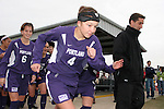 Kari Evans (4), Angie Woznuk (6) and head coach Garrett Smith (r) lead Portland onto the field. The University of Portland Pilots defeated the UCLA Bruins 4-0 to win the NCAA Division I Women's Soccer Championship game at Aggie Soccer Stadium in College Station, TX, Sunday, December 4, 2005.