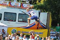 FIERLJEPPEN: VLIST: 22-08-2015, NK Fierljeppen/Polstokverspringen, Klaske Nauta (dames) springt 16.31m, ©foto Martin de Jong