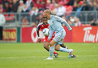 Sporting KC midfielder Ryan Smith #11 and Toronto FC defender Danleigh Borman #25 in action during an MLS game between Sporting Kansas City and the Toronto FC at BMO Field in Toronto on June 4, 2011..The game ended in a 0-0 draw...