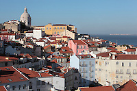 View over the rooftops of Alfama, the oldest district in the city and the original Moorish area, with the dome of the Church of Santa Engracia, Lisbon, Portugal, with the Tagus river estuary behind. Picture by Manuel Cohen
