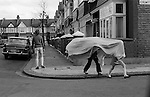 Children playing with bedsheets in the street. Wandsworth SW London UK./<br /> <br /> 16x12 PARIS 2015 LES DOUCHES LA GALERIE <br /> <br /> THIS ARE MEDIUM RES FILES ONLY FOR REFERENCE AND SHOULD NOT BE SENT OUT THEY OPEN AT 11MGB